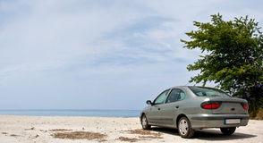 Car at the beach royalty free stock photography