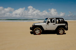 Car on the beach Royalty Free Stock Image