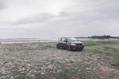 Car on beach Stock Image