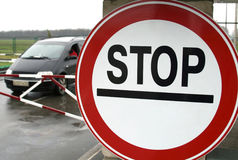 Car behind the stop sign at boundary checkpoint Stock Photo