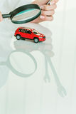 Car is being examined by doctor Royalty Free Stock Images