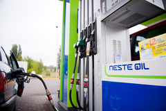 A car being filled up with diesel in Neste Oil A24 automatic fuel station Royalty Free Stock Image