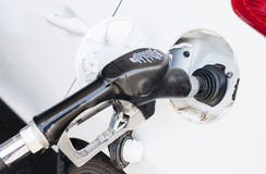 A car is being Refilled with Gasoline Royalty Free Stock Images