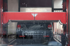 Car being washed in an automated car wash Royalty Free Stock Image
