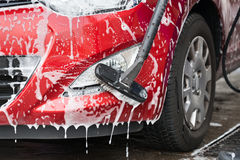 Car Being Washed By Scrubbing Brush Royalty Free Stock Images