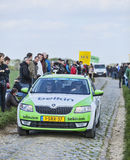The Car of BelkinTeam on the Roads of Paris Roubaix Cycling Race. Carrefour de l'Arbre,France-April 13,2014: The official car of Belkin team driving in front of Stock Photo