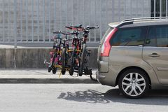 Car with a bicycle rack transportation. Image of car with a bicycle rack transportation stock photos
