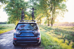 Car with bicycles in the forest road Royalty Free Stock Images