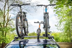 Car with bicycles on it. Car with two bicycles and one runbike Royalty Free Stock Photo