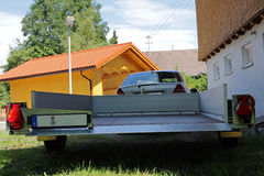 Car with a big trailer Stock Images