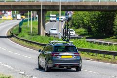 Car with bike on uk motorway in fast motion.  stock images