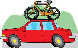 Car and Bikes. Travelling red car with two bikes on the roof Royalty Free Stock Images
