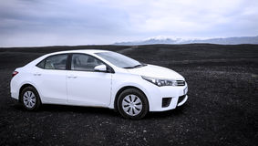 Car on a black beach, Iceland stock photography