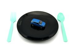 Car on black dish ready to serve for breakfast lunch dinner. 4WD Car on black dish ready to serve for breakfast lunch dinner Royalty Free Stock Photo