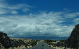Car on Black Top Road Under White and Blue Sky during Daytime Royalty Free Stock Photo