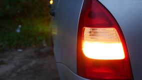 Car blinker is blinking in the evening stock footage