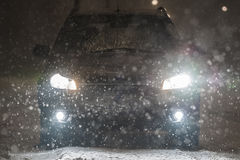 Car in blizzard. A car in blizzard night Royalty Free Stock Photos