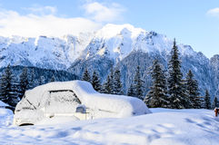 Car blockaded in snow. Y mountains Royalty Free Stock Image