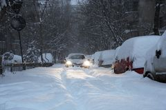 Car blocked on a road covered by snow stock photo