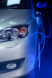 Car blue flash. Front headlights of the car white blue halogen Royalty Free Stock Photography