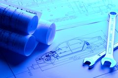 Car blueprint with Wrench. Car blueprint rolls with Wrench in blue light stock photos
