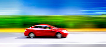 Car in blurred motion on road. Abstract background. Royalty Free Stock Image