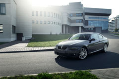 Car BMW Coupe E92 standing on asphalt road in city Minsk, Belarus near modern building at daytime Stock Images