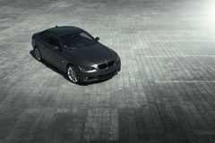 Car BMW Coupe E92 standing on sett empty parking lot at daytime Stock Photos