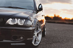 Car bmw. Part of black car BMW and sunset stock photography