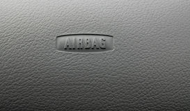 Car Board Air Bag Sign. Air bag sign on black wrinkle textured car board Royalty Free Stock Images