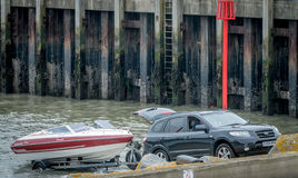Car and Boat on the Slipway. Car on a slipway, with a boat loaded onto its trailer, ready to drive away Royalty Free Stock Photos
