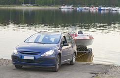 The car with a boat on the trailer Stock Photo