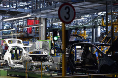 Car bodies on the production line. Inside automobile factory Stock Image