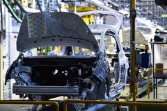 Car bodies on the production line. Inside automobile factory stock photography