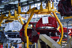 Car bodies on the production line. Inside automobile factory Royalty Free Stock Image