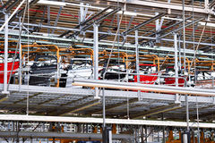Car bodies on the production line. Inside automobile factory stock images