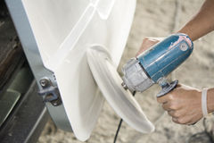 Car body color polishing by electric drill. Auto body repair Royalty Free Stock Photos