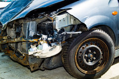Car with body damage after an accident. A car with body damage after an accident in a car workshop stock photography