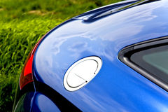 Car body and fuel filler cap. Close-up of fuel filler cap and car body royalty free stock photography
