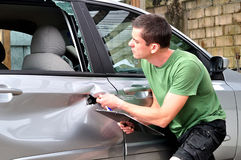 Car body mechanic checking out damage. Stock Image