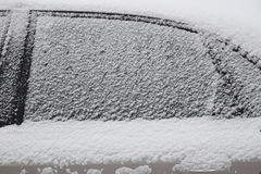 Car body part covered with white snow Stock Photos