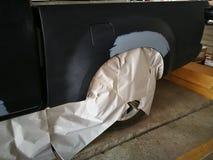 Car body repair. Crashed car in repair station stock images