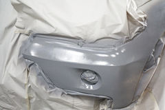 Car body work auto car repair paint after car accident during the spraying Stock Photos