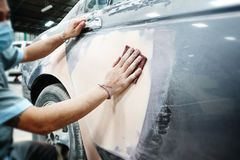 Car body work auto repair paint after the accident during the spraying. Car body work auto repair paint after the accident Royalty Free Stock Image