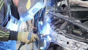 Car body worker welding car body stock video footage