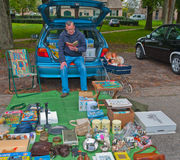 Car boot sale in a small Dutch village. Car boot sale in the small Dutch village of Den Hout, North Brabant. Car boot sale in a village in the Netherlands on Royalty Free Stock Image