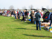 Car boot sale. A car boot sale. Unwanted items are sold from the back of vehicles. These sales are very popular during the summer months in the United kingdom stock photo