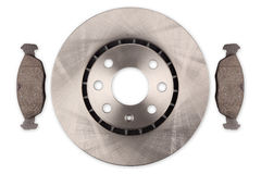 Car brake disc with brake pads. A car brake disc  with brake pads isolated on white background Stock Photography