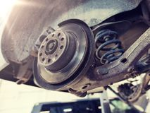 Car brake disc at repair station. Auto service and maintenance concept - car brake disc at repair station stock photography