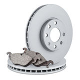 Car brake discs and pads. Pair of car brake discs and pads on white background Royalty Free Stock Photos